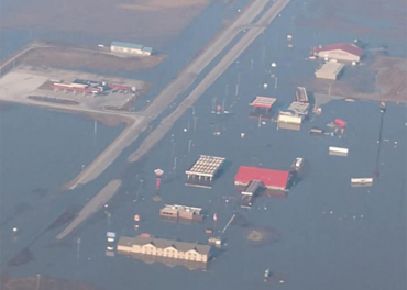 Multiple truck stops are under water because of historic flooding
